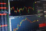 Americké akcie výrazně oslabily kvůli nepříznivým hospodářským údajům z Číny a Evropy, dolar naopak stoupl